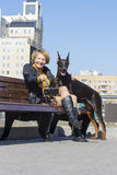 Pretty adult woman with dog outdoors Royalty Free Stock Image