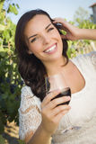 Pretty Adult Woman Enjoying A Glass of Wine in Vineyard Stock Photo