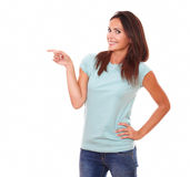 Pretty adult woman pointing to her right Stock Images