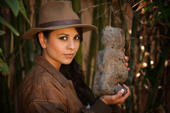 Pretty adventurer with relic Royalty Free Stock Photo