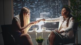 Pretty african american business woman showing her engagement ring to the friend. At the meeting. They are very excited and happy stock footage