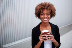 Pretty African American executive with mug royalty free stock photos