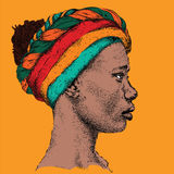 Pretty African American Girl in a colorful turban. Beautiful black woman. Profile view. Hand draw vector illustration Royalty Free Stock Image