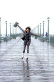 Pretty African American girl jumping on the pier Royalty Free Stock Photos