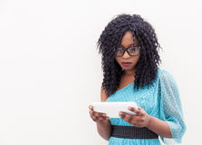 Pretty african american girl looks at his laptop Stock Photos