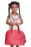 Pretty african american small girl dressed as an adult and carry Royalty Free Stock Image
