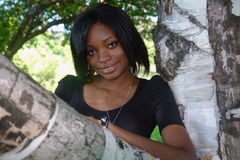Pretty African American woman. Portrait of a pretty African American woman in a birch tree Stock Photography