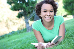 Pretty African American Woman Reading Stock Images