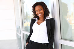 Pretty African Business Woman. Pretty african american business woman at office building Stock Image