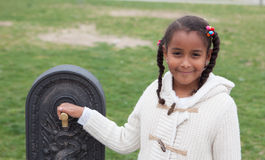Pretty african child by a fountain Royalty Free Stock Images