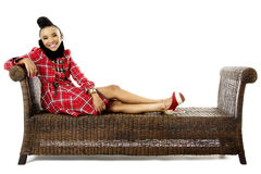 Pretty African Fashion Model Relaxing on an Traditional Bench Stock Photography