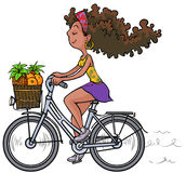 Pretty african girl on bike. Royalty Free Stock Photo