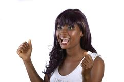 Pretty african girl cheering. Studio, shot, Cameroon Royalty Free Stock Photography