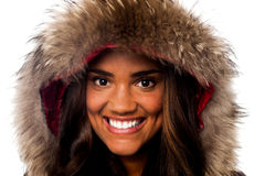 Pretty African girl in fur hood royalty free stock image