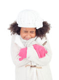 Pretty african girl with gesture of being cold and warm clothing Stock Images