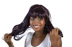 Pretty african girl holding hair. Studio shot, Cameroon Royalty Free Stock Photography