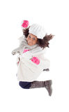Pretty african girl jumping with winter clothes Royalty Free Stock Photo