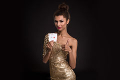 Pretty african girl shows two aces in casino poker and win Stock Photos