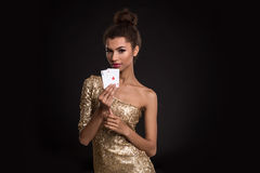 Pretty african girl shows two aces in casino poker and win Stock Image