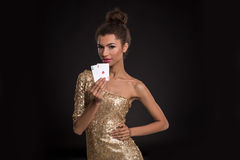 Pretty african girl shows two aces in casino poker and win Stock Images