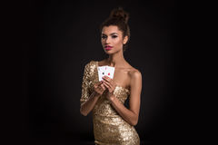 Pretty african girl shows two aces in casino poker and win Royalty Free Stock Photography