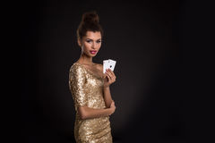Pretty african girl shows two aces in casino poker and win Stock Photo