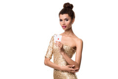 Pretty african girl shows two aces in casino poker and win Royalty Free Stock Photo
