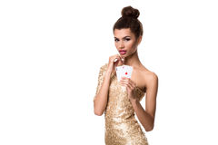 Pretty african girl shows two aces in casino poker and win Royalty Free Stock Images