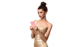 Pretty african girl shows two cards in casino poker and win Royalty Free Stock Photo