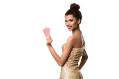 Pretty african girl shows two cards in casino poker and win Royalty Free Stock Image