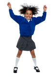 Pretty African school girl dances in full swing Royalty Free Stock Images