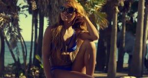 Pretty African Woman in Bikini Sitting on Bench Stock Image