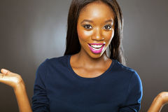 African woman surprised. Pretty african woman looking surprised Stock Photo