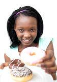 Pretty african woman showing a donuts Royalty Free Stock Photography