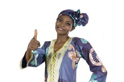 Pretty african woman in traditional clothes thumb up Royalty Free Stock Photo