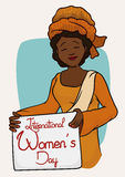 Pretty African Woman with Traditional Clothes and Women's Day Message, Vector Illustration. Smiling African woman with turban and traditional clothing holding a Stock Image