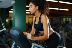 Pretty afro-american  fit girl working out at gym Stock Images