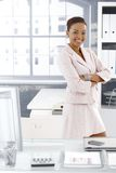 Pretty afro office girl at desk Royalty Free Stock Photo
