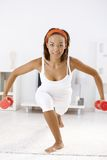Pretty afro woman with dumbbells Royalty Free Stock Photography