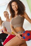 Pretty afro woman exercising with ball Stock Image