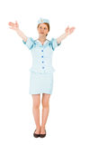 Pretty air hostess with arms raised. On white background royalty free stock image