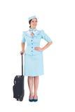 Pretty air hostess holding suitcase Stock Photos