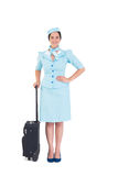 Pretty air hostess holding suitcase Royalty Free Stock Photo