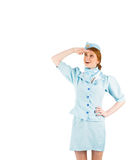 Pretty air hostess looking up Royalty Free Stock Photos