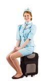 Pretty air hostess smiling at camera Stock Image