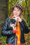 Pretty amateur photographer. In autumn park stock images