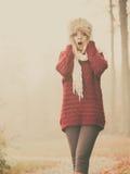 Pretty amazed fashion woman in fur winter hat. Royalty Free Stock Image