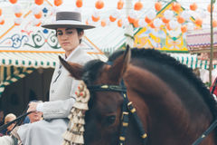 Pretty amazon wearing traditional Andalusian uniforms at the April's Fair of Seville Stock Photo