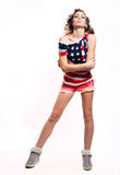 Pretty American girl on white. Full length portrait  of serious whimsical beautiful young  American patriotic girl wearing colorful head band, red shorts Royalty Free Stock Image