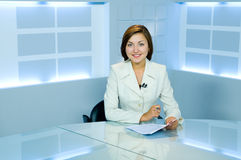 Pretty anchorwoman at light TV studio Stock Photography
